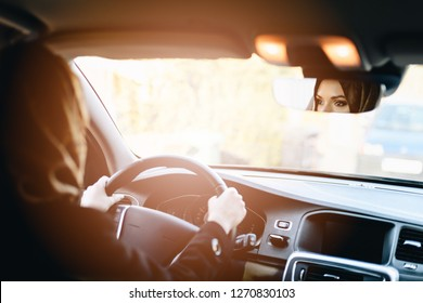 Middle eastern ethnicity woman in car as driver. Arabic woman in hijab driving a car