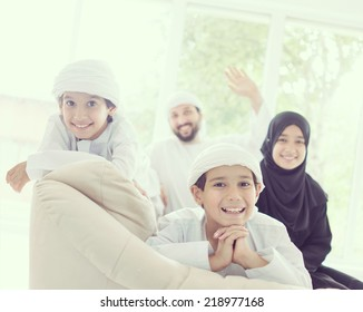 Middle eastern family at home on couch