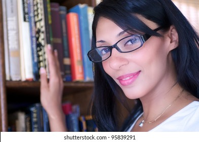 A middle eastern female in a library