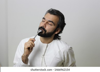 Middle Eastern Man Eating Very Happy Enjoying The Taste