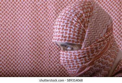 Middle Eastern Man in Red and White Headscarf with Identical Background.