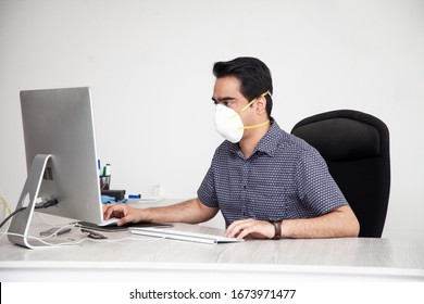 Middle Eastern man wearing a protective mask at work for corona virus treatment