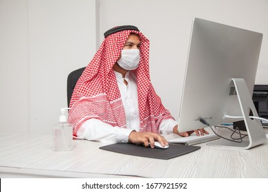 Middle Eastern man wearing a protective mask at work for corona virus treatment working at office