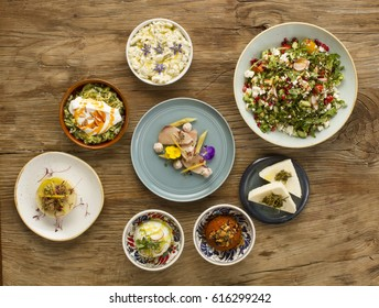Middle eastern or mediterranean dishes and assorted meze on a dark background