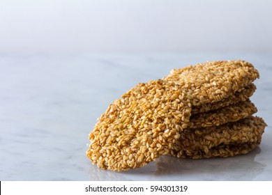 Middle Eastern Sesame Cookies in a Stack on Light Background Copy Space Horizontal