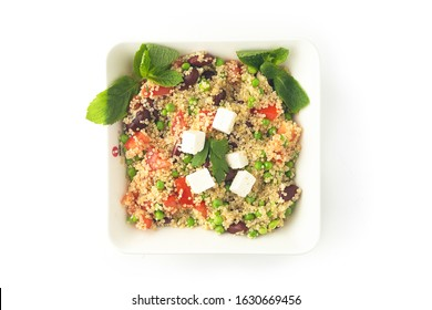Middle eastern, vegetarian and vegan cuisine. including falafel, hummus, baba ganoush, fatteh, pitta, feta sald, moutabal, tahini, tabbouleh, ful medammes, many vegetables on white background isolated