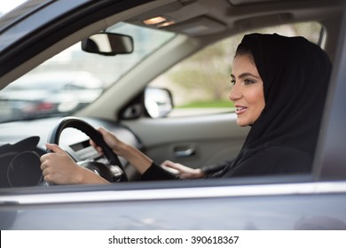 Middle Eastern Woman Driving a Car, Looking Forward