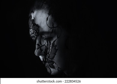 Middle Eastern woman portrait looking sad with a black hijab artistic conversion