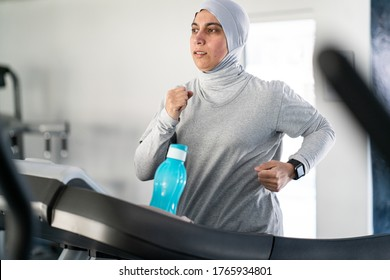 Middle Eastern Woman Running on Treadmill