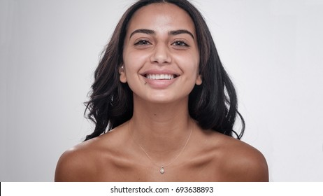 Middle Eastern Woman smiling with no makeup