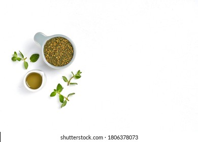 Middle Eastern zaatar spices with fresh zaatar leaves and olive oil. Top view with copy space
