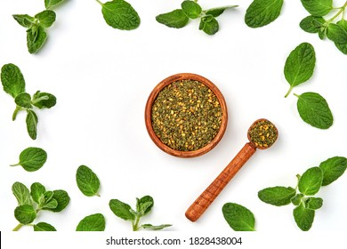 Middle Eastern zaatar spices with fresh zaatar leaves  . Top view with copy space
