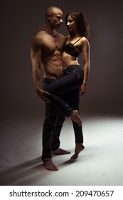 Middle Fashion Jeans Photo Shoot. Age Couple Showing Sexy Body Portrait, Isolated on Gray Background.