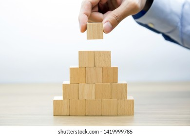 Middle  Fifteen Wooden cube Stacked in  Pyramid shape  without graphics for Business and design concept, Symbol of leadership, Teamwork and Growth.