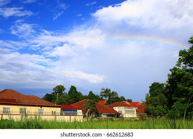 The middle house meadows with a rainbow with the cloud  in Thailand
