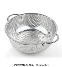 A middle metal colander on a white isolated background. Kitchen accessories.