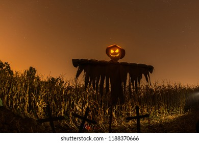 In the middle of the night over cornfield a sinister scarecrow