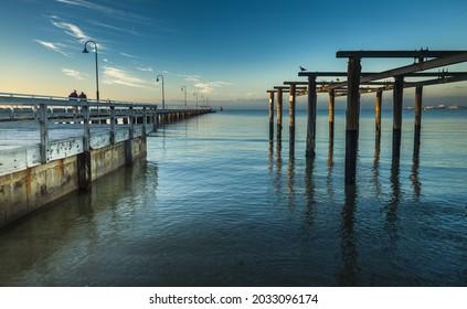 Middle park pier sunrise beach fishing reflections bay area Melbourne city