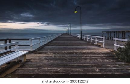 Middle park stormy sunrise Melbourne city beach pier coastal bay
