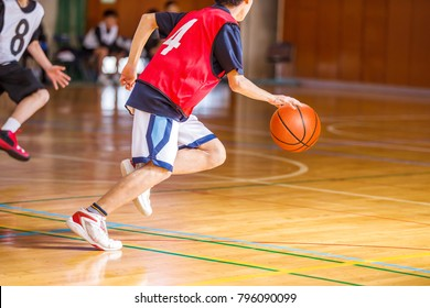 Middle school student playing basketball game