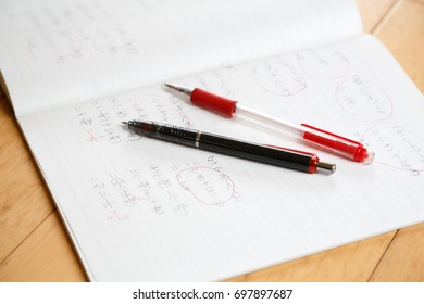 Middle school students math notes and pen