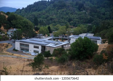 Middle school surrounded by greed trees and brown grass in Marin County, California