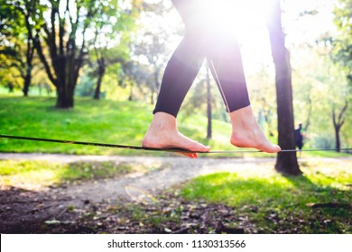 middle section human feet slacklining - balance, sport, tightrope concept