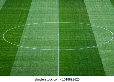 Middle of soccer field with textured background grass