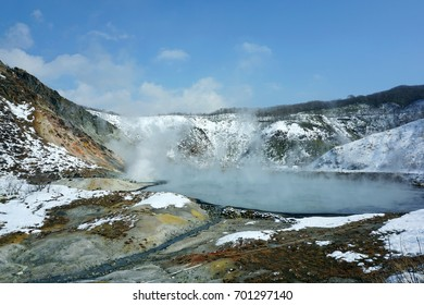 Middle valley with hot spring And covered with snow began to melt. From the light of the sun And hot steam from the hot spring