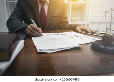 Middle-age of male lawyer working with legislation contract paper in courtroom, attorney justice and law concept.