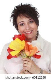 Middle-age woman holding spring tulip  flower, white background