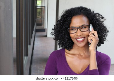 Middle-aged African woman talking on her cell phone