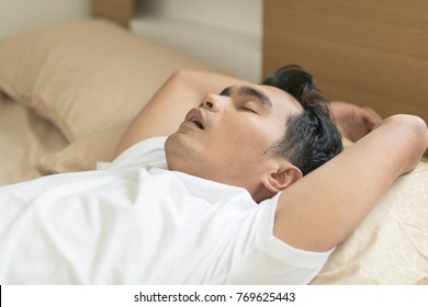 Middle-aged Asian men have problems breathing and snoring concepts