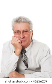 middle-aged businessman sitting pensively against a white background