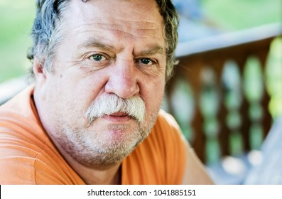 middle-aged caucasian man portrait, outdoor
