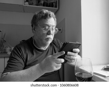 middle-aged caucasian man with tablet PC