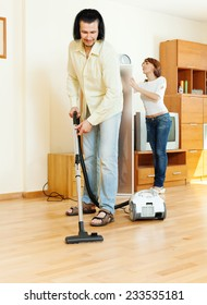 middle-aged couple are doing house cleaning