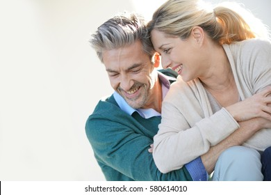 Middle-aged couple embracing each other