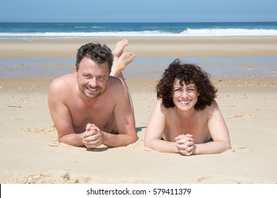 middle-aged couple on the beach doing nudism or naturism