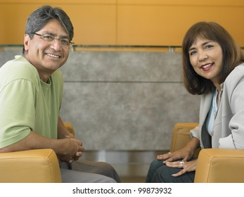 Middle-aged couple smiling for the camera