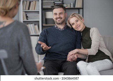 Middle-aged couple solving problems during marital therapy with a psychologist
