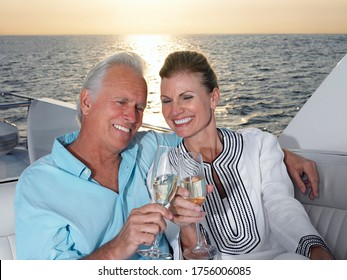 Middle-aged couple toasting with champagne