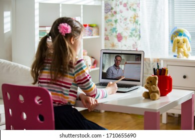 Middle-aged distance teacher having video conference call with pupil using webcam. Online education and e-learning concept. Home quarantine distance learning and working from home.
