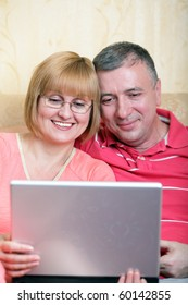 Middle-aged family enjoying their life surfing the internet