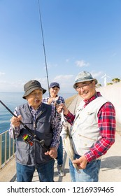 Middle-aged Japanese group enjoying fishing