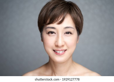 Middle-aged Japanese woman smiling from the eyes