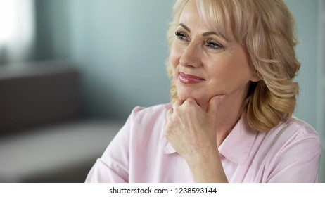 Middle-aged lady dreaming about retirement and around world cruise, positivity