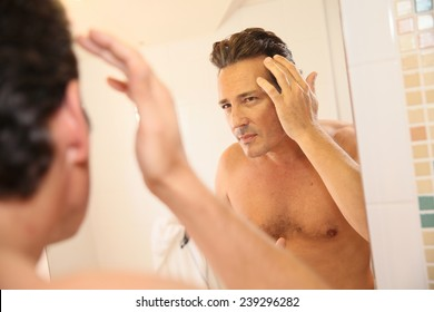 Middle-aged man concerned with hair loss