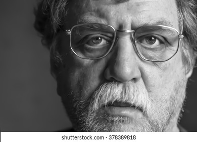 middle-aged man in eyeglasses, selective focus