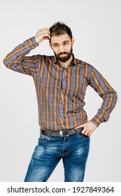 Middle-aged man in faded jeans and shirt on white background showing different emotions.